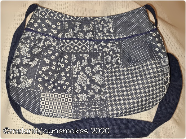 soft bodied pleated bag with fleece lining and webbing handle